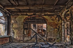 A photo of the dilapidated interior of a building.