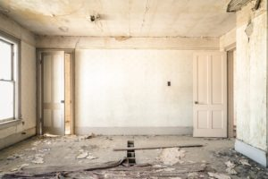 A photo of a dilapidated room.