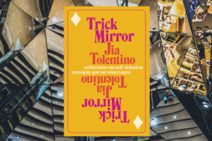 The book cover of Trick Mirror (solid yellow with pink text) overlays an image fractured by many reflecions.